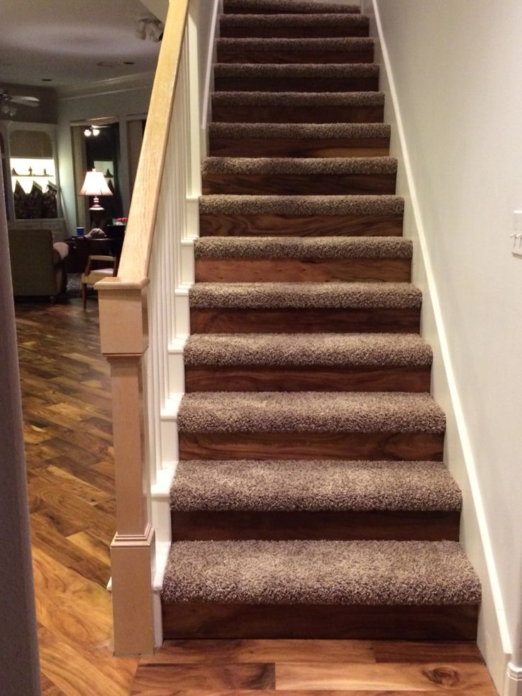 Hickory flooring risers with carpet treads to transition from downstairs wood flooring to upstairs carpet.