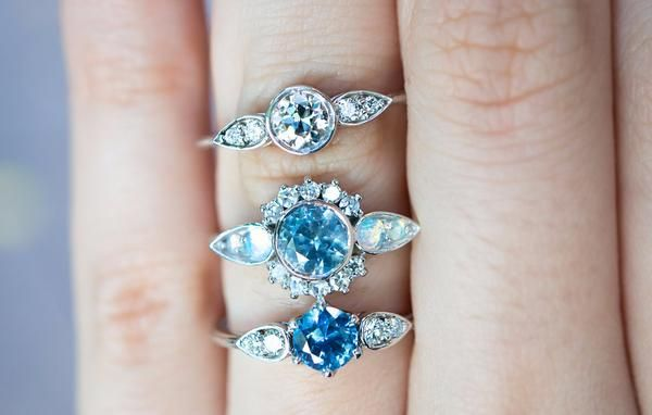 Our contemporary interpretation of the classic Sapphire engagement ring. Set with a glow-y, saturated, sky blue Montana Sapphire and four reclaimed diamonds. Th