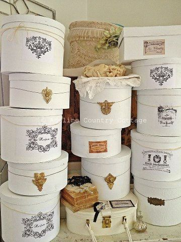 paint old hat boxes white and decorate/decoupage with images from   1800's magazine like La Mode llustree
