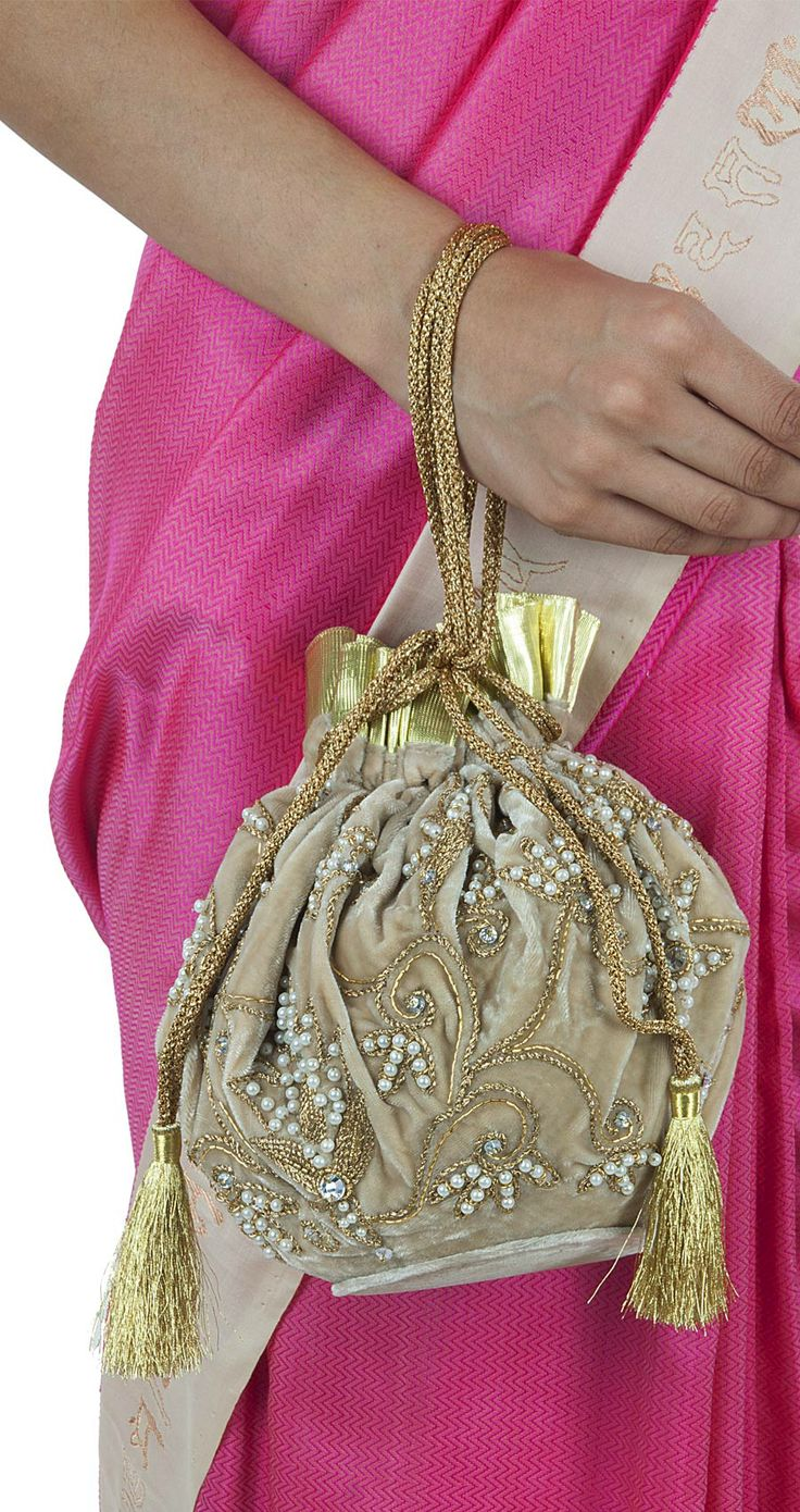 Dull gold embroidered potli available only at Pernia's Pop-Up Shop.