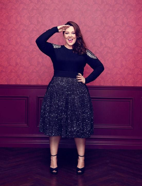Melissa McCarthy Seven7 is packed with holiday party outfit ideas that will flatter any figure, including a midi with a thin sweater tucked in. Click for more!