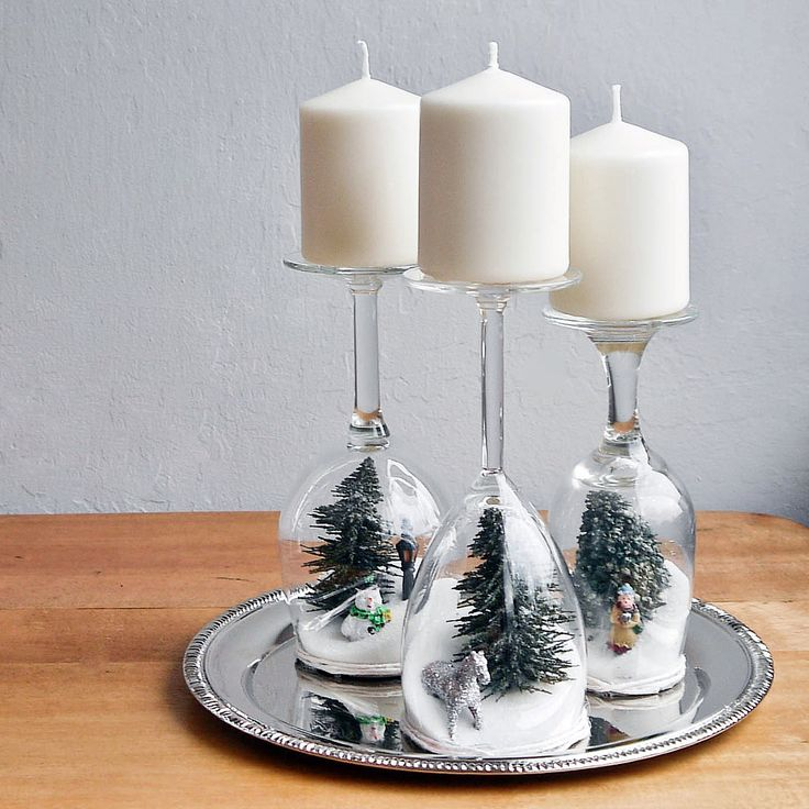 Let It Snow With Dollar-Store Holiday Dioramas: Head to the dollar store and pick up a collection of wine glasses, a box of sugar, and a few kitchy holiday figurines — or even plastic ornaments — for making these easy holiday dioramas.