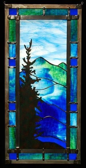 Hanging stained glass mountain landscape by Magruder Glass in Asheville, North Carolina.   Carolina Hemlock