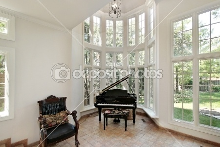 Breathtaking wall of windows in a piano nook.