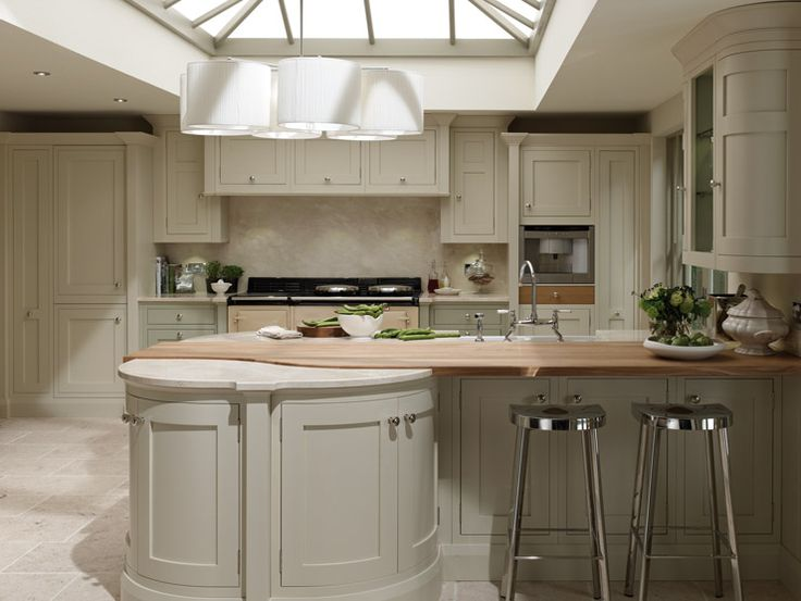 A very unique worktop combination gives this kitchen a wow factor and a cleverly integrated seating area