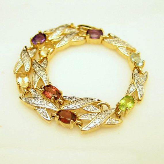 Gold Plated Vintage Beaded Links  Bracelet with Glass Gemstones - This bracelet is an eye-catcher and the multi color stones can coordinate with a variety of looks! Pair with a cream colored top or sweater for a rich look or add some color to your LBD. See it at - https://www.etsy.com/listing/171957205/vintage-beaded-links-bracelet-glass?ref=shop_home_active_24 #Vintage #Bracelet #Gold #Gemstones #MyClassicJewelry