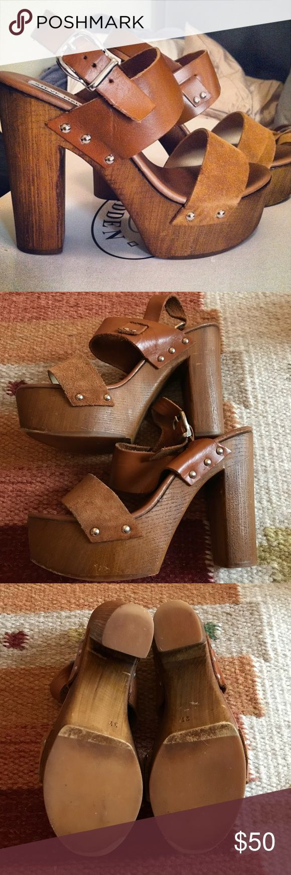 """Steve Madden Wedges Ridiculously cute Steve Madden wooden wedges with leather and suede straps. In good condition with signs of wear as seen in pictures (note first picture was when they were brand new). Just a little too big on me, so decided to sell! I think fit either a 7 or 7.5 because the straps have some give to them. These are rare!! Originally purchased from South Moon Under. Heel height is ~5"""" Steve Madden Shoes Wedges"""