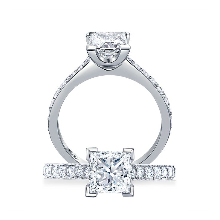 Treat your lady like a princess with the Paul Bram Princess Cut engagement ring with millegrain shoulders! This ring has a striking princess cut solitaire ring in an open V-claw setting accentuated by brilliant cut diamonds in the shoulders. Handcrafted in 18ct gold or platinum.   #paulbram #paulbramdiamonds