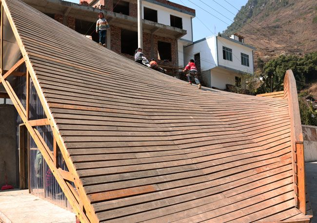 Climbing up the roof.