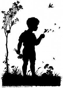 Boy in fairy garden blowing dandelions..silhouette