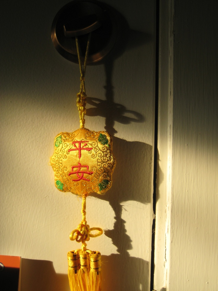 Typical Chinese decoration on the lock of our fire escape door. The sun hits this perfectly every day around 2:45 and lasts til about 3 (in the winter). The characters are ping an- means safe and sound.