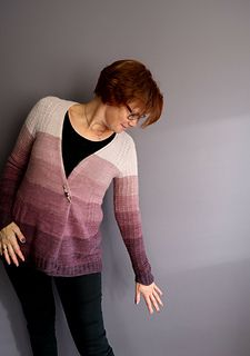 Diane is an intricate and delicately textured Cardigan with feminine shapes, that can be worn either wrapped (by adding a closure at the side) or open, for a more casual but still flattering look. Its ample, shapely lower body with the curved hem will help in simulating an hour-glass figure, however one chooses to wear it.
