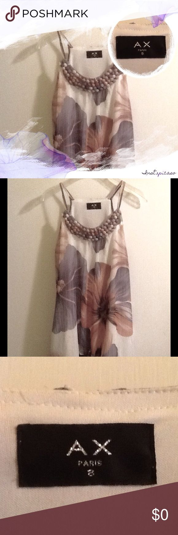 🆕💕ARMANI EXCHANGE Abstract Floral Balloon Hem💕 💕 GORGEOUS ARMANI EXCHANGE Sleeveless Abstract Floral Top/Tunic has lingerie straps and flirty balloon skirt.  Little ball buttons decorate the scoop yoke.💕  Much prettier than photo.  Ivory, with Peach and periwinkle abstract floral design.  Fully lined.  Size 8.  EUC. Armani Exchange Tops Tunics