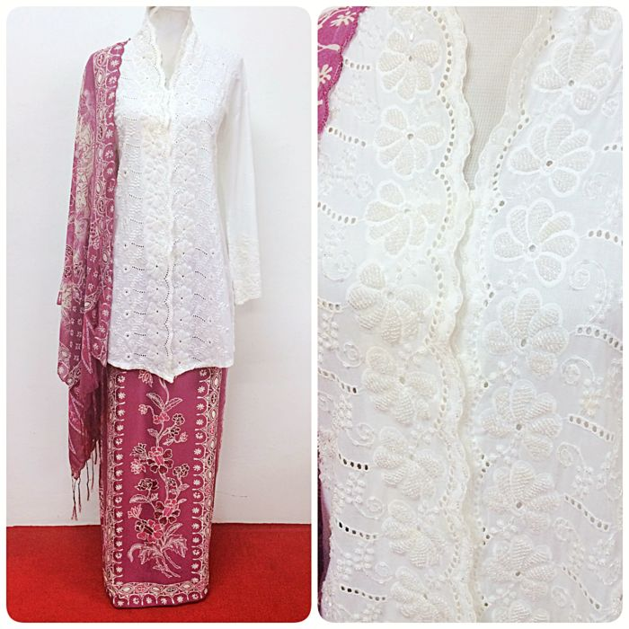 Celebrate Eid Fitr this year in this beautiful fully beaded long kebaya paired with a batik silk sarong and chiffon shawl. Shop now at www.empireofelegance.com.my