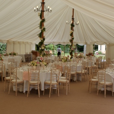Gorgeous Traditional Marquee With Full Interior Lining Round Tables Abundance Of Beautiful Flowers And Greenery Weaved Perfectly Around The Poles