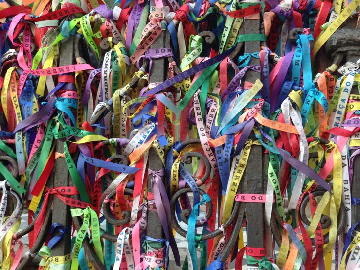 Nosso Senhor do Bonfim, Salvador do Bahia  Fitas or wishing ribbons of the Church of Nosso Senhor do Bomfim known for its miracles & healing powers. They are tied to the gates of the church or to the wrist with 3 knots each representing a wish. Wishes are always made for someone else & ribbons are always meant for gifting not for the self. They remain on until they fall off in which the wishes then come true.  A beautiful tradition dating back to the early 1800s.