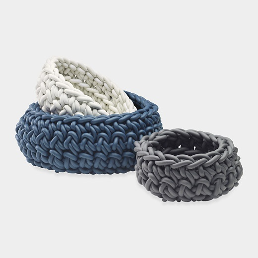 Product DescriptionNeo Baskets  These hand-knitted baskets are made from neoprene yarn, an inviting and flexible industrial rubber that is soft to the touch. Hand-wash with warm water and mild soap.