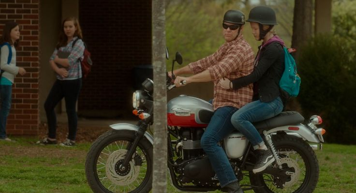 Triumph Scrambler (2014) motorcycle and Vans shoes in THE BOSS (2016)…