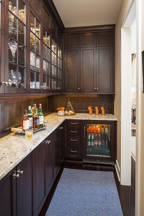 Traditional Long Butlers Pantry Features Brown Stained