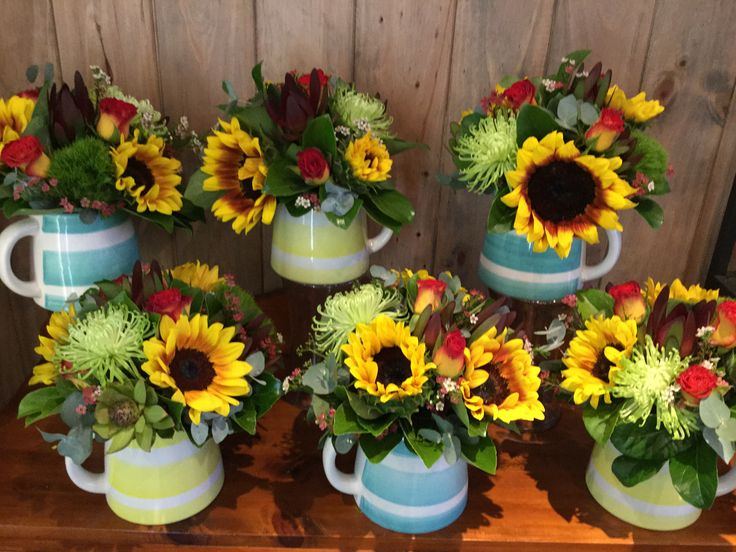 Sunflower milk jugs, for a Melbourne Cup day funtion at QT Hotel, designed by Twigs Florist Varsity Lakes