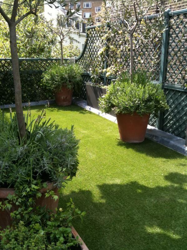 painted privacy screen---maybe dark brown?  dark grey? Easigrass Inspiration Gallery - Artificial Grass Gardens & Ideas