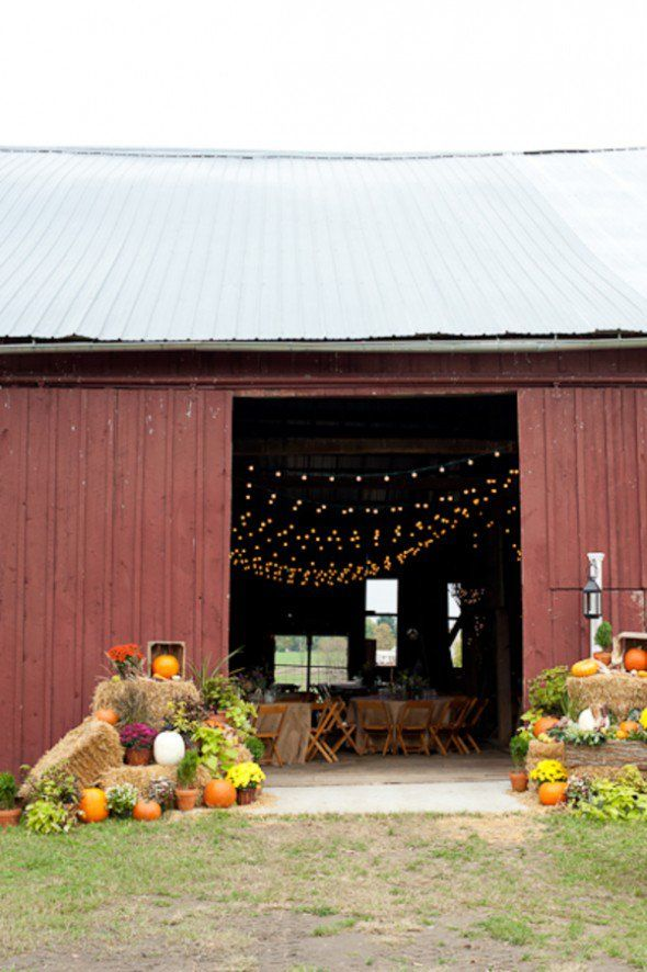 Fall Barn Wedding, I love how they have the pumpkins, flowers and hay bales decorating the entrance