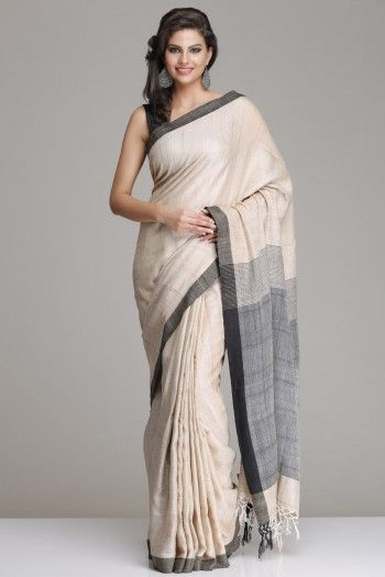 Light Beige Hand-Woven Tussar Silk Saree With A Black Border And Pallu
