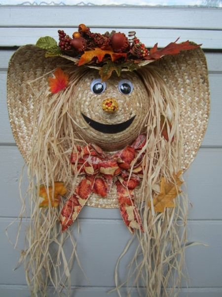 Scarecrow wreath out of a straw hat. There are no instructions , but sure it can be easily made.