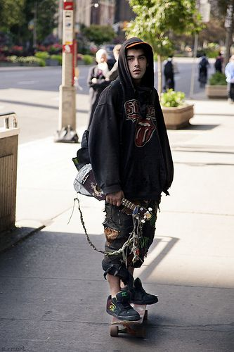 skater boy equipped with ear torture.  decks are big this summer  .