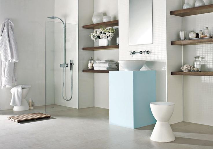 concrete floor, wood vanities, white tiles with retro blue accessories. the master ensuite