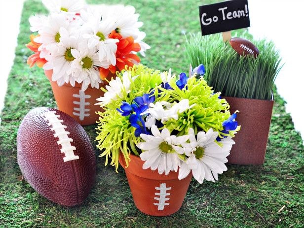 Terra Cotta Pots Make Adorable Football Centerpieces! Perfect For Your Super Bowl Party --> http://www.hgtvgardens.com/entertaining/super-bowl-centerpiece-ideas?soc=pinterest