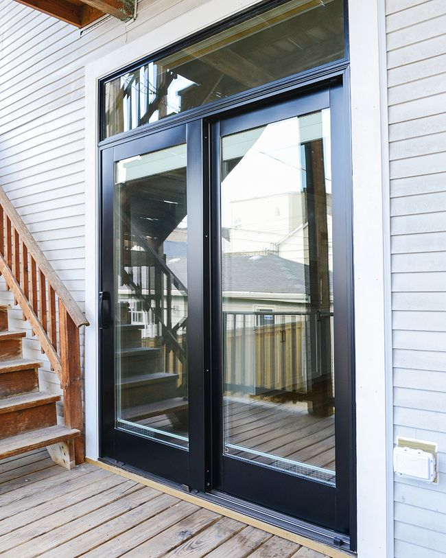 "Door! Door! Door! - ""We've always loved the look of a dark door against lighter siding, and although there was a bit of a debate at first, we chose a black exterior finish. It's so striking; we couldn't love it more"""