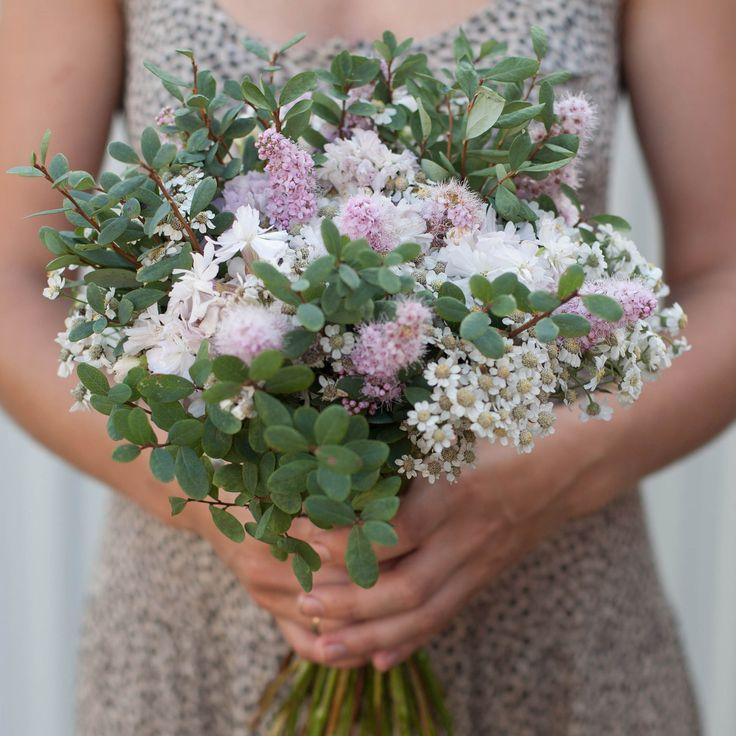 Saponaria, wild achillea flowers and bog whortleberry greens