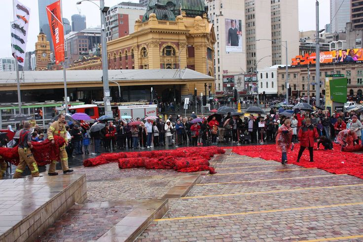 Rolling up the carpet of poppies - each panel measured 10mx1m