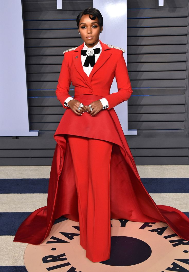 JANELLE MONAE wears a fitted red Christian Siriano suit with peplum and train to the Vanity Fair party.  Janelle is sooo creative and courageous in her fashion choices.  Love her!