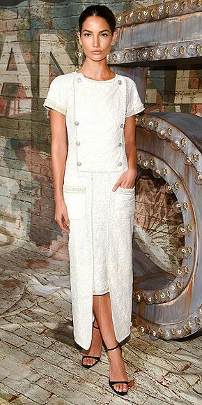 LILY ALRIDGE The Sports Illustrated cover girl puts a modern spin on a classic Chanel silhouette, in a modest cream-colored look from the line and strappy of-the-moment sandals for a dinner celebrating the new Chanel No. 5 campaign in N.Y.C.
