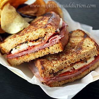 Italian Panini with Tomato Olive Spread  spread:  -1/4 cup pimento-stuffed green olives  -1/4 drained ripe black olives  -1 Tbsp capers  -4 sundried tomatoes  -1 Tbsp EVOO    everything else:  -8 slices whole wheat bread  -8 slices of hard salami  -4 slices of honey ham  -24 small slices of pepperoni  -4 ounces of cheese (sliced or shredded)  -EVOO for drizzling