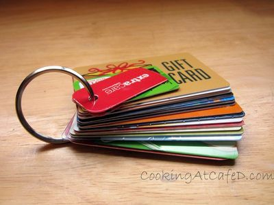 Save space in your wallet & organize all your gift & store rebate cards by putting a hole punch through them and adding them to a key ring.