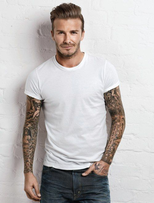 David Beckham - sleeved out devoted father and husband, famous soccer star, multi-millionaire - tell me again how tattoos are trashy...