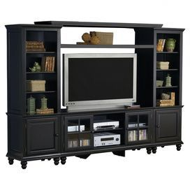 "Enjoy the big game or classic movie screenings in style with this comprehensive entertainment center. Crafted of wood, this timeless design showcases 2 storage towers for stowing accessories and decor, and 1 center console for all your electronics.   Product: Entertainment centerConstruction Material: Solid wood, veneers and glassColor: Satin blackFeatures:  Two glass front cabinetsAdjustable shelves  Dimensions:74"" H x 108.25"" W x 18.25"" DNote: TV and accents not included"