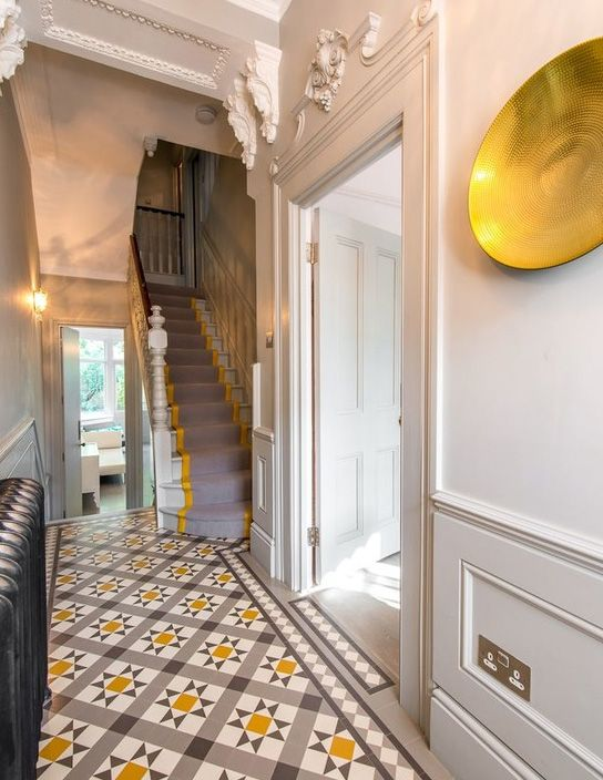 Ornate Edwardian or Victorian hallway with tiled floor