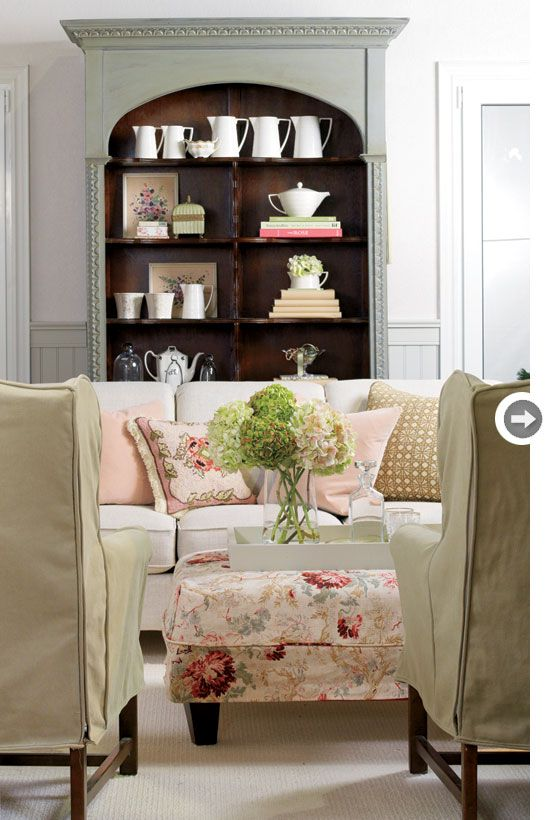 Unify disparate furniture colours (like the blush pink and sage green used here) with a neutral backdrop that has undertones of both colours.
