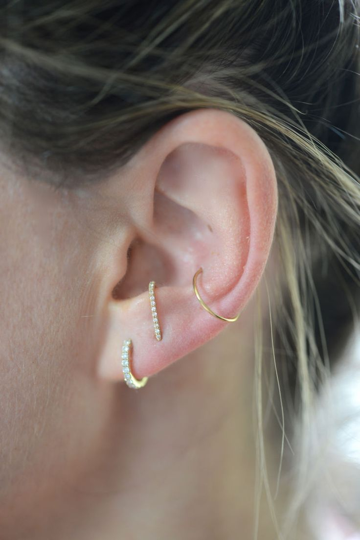 Current ear situation. Left to right: XIV Karats diamond huggies, Smith   Mara suspender earring c/o, no name gold hoop