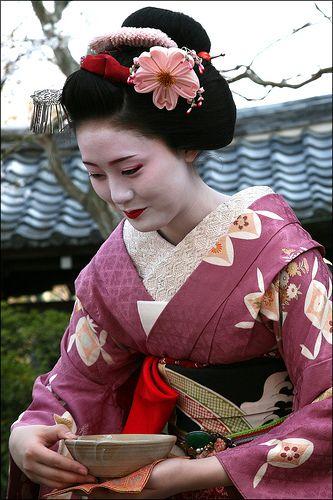 Butterflies of the Night: Mama-Sans, Geisha, Strippers ...  Man Serves Geisha