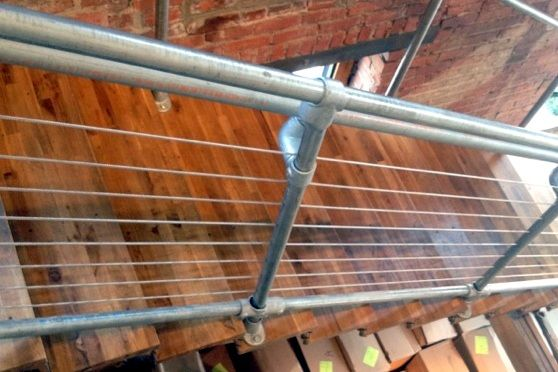 A cable rail system that can be attached to Kee Klamp pipe railing.