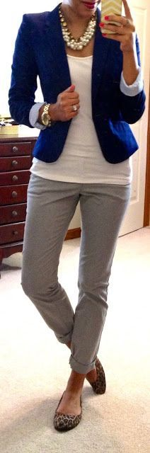 Grey pants, bright blue blazer, simple white tee, chunky jewelry and leopard flats