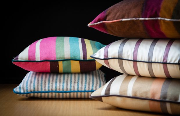Fabulous multi-color stripes in vibrant and energetic shades or in a palette of warm tones for BROCHIER cushion collection.