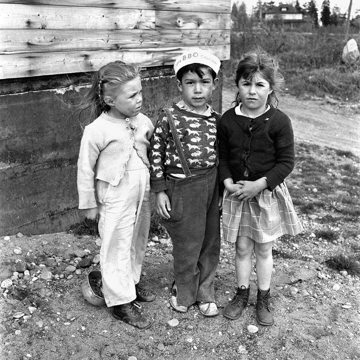 A little boy in a sailor hat between two little girls. Untitled, Undated