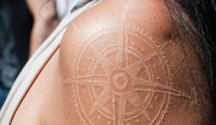White ink compass tattoo