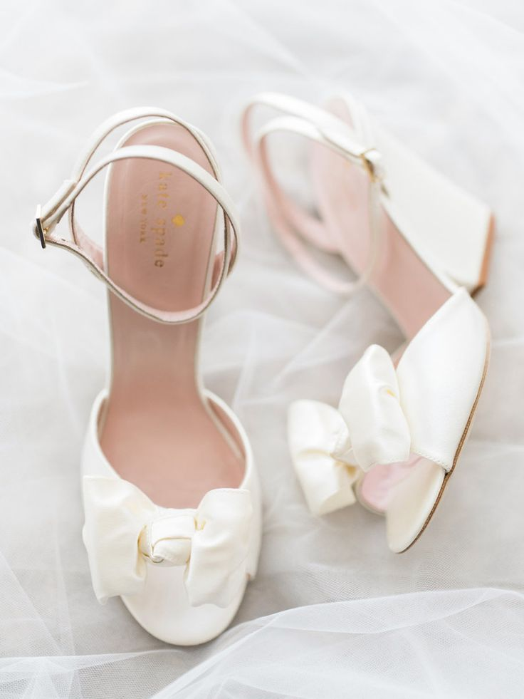 Satin bow Kate Spade wedding shoes. Photography : Troy Grover Photographers Read More on SMP: http://www.stylemepretty.com/little-black-book-blog/2016/08/05/destination-hawaiian-wedding-dreams-made-of-these/